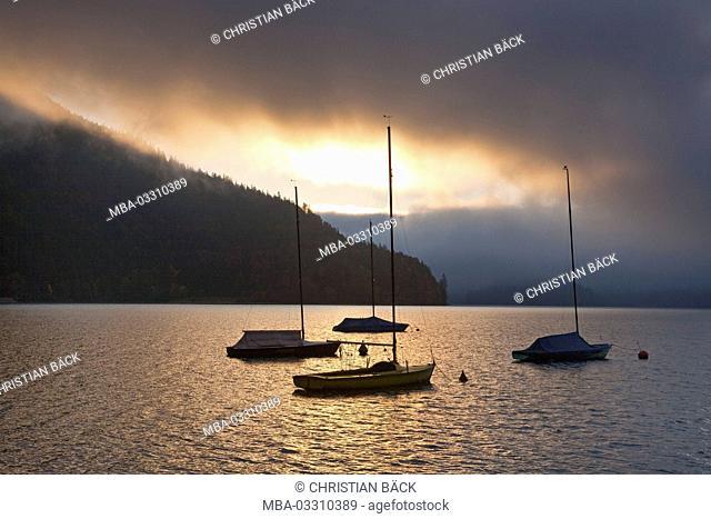 Sailboats with an runwaying thunderstorm at Lake Walchensee, Urfeld, Upper Bavaria, Bavaria, Germany