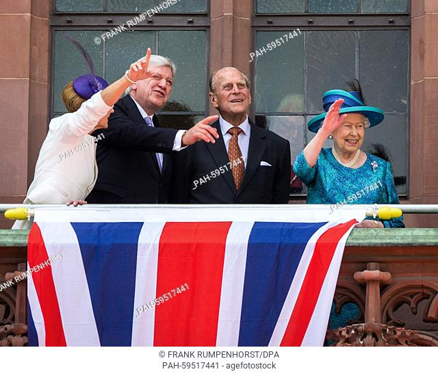 Volker Bouffier (2-L), Premier of the German state Hesse, his wife Ursula (L), Britain's Queen Elizabeth II (R) and Prince Philip wave as they stand on the...