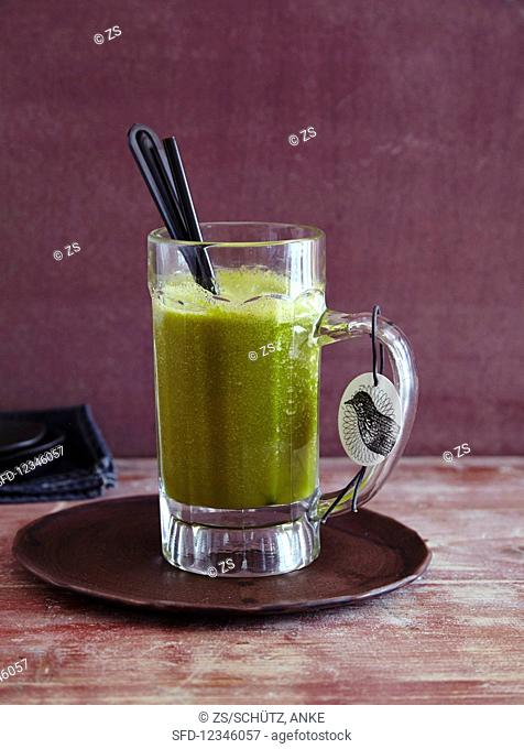 A pumpkin and lettuce smoothie with orange - 'Halloween Monster'