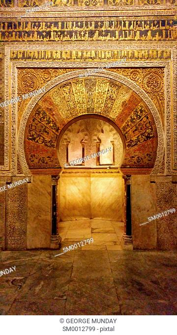 The arched Mihrab or prayer niche used to identify the wall that faces Mecca,. The Prayer Hall in the 10th Century Mezquita Mosque, Cordoba City