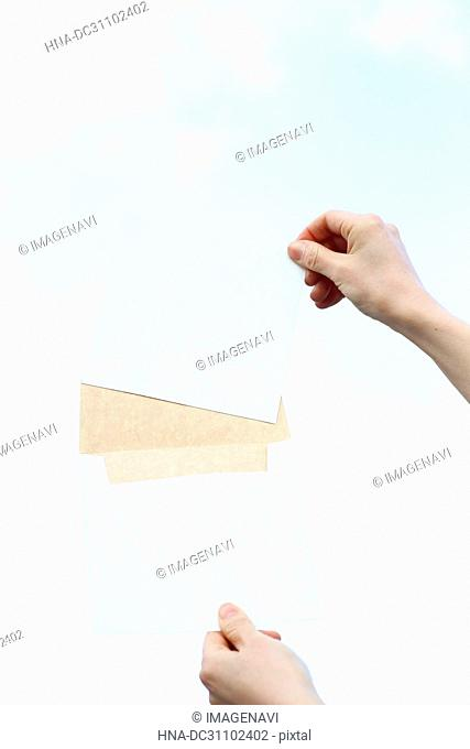 Woman Hand Holding Envelope