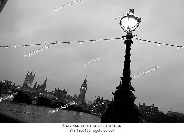 England Lamposts Over River Thames At Night with Big Ben and Houses Of Parliament in Background, London, United Kingdom