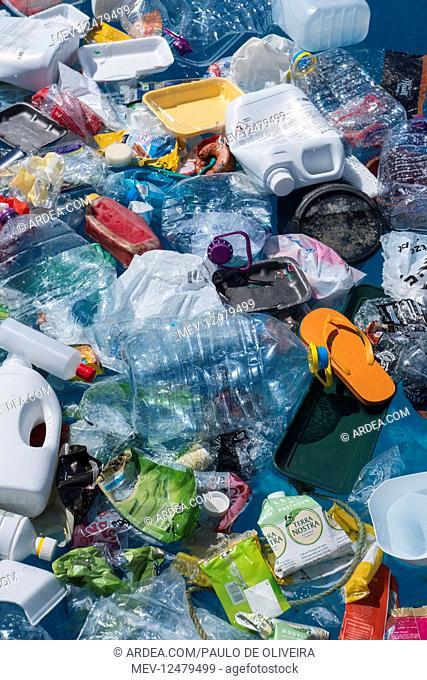 Plastic garbage floating in the ocean. Unlike