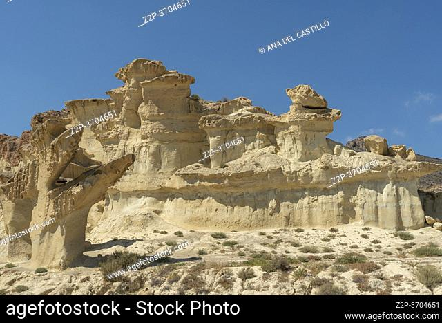 Murcia Spain on September 5, 2020: The surreal sandstone rocks of Bolnuevo with sunlight in blue sky with light clouds near Mazarron on the Costa Calida