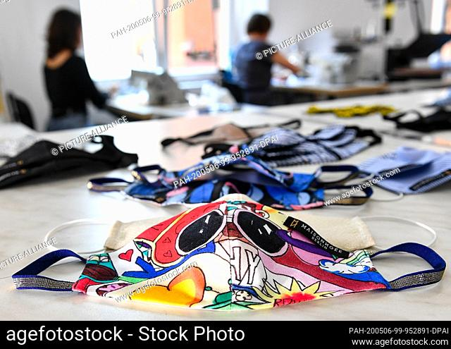 28 April 2020, Berlin: Mouth and nose masks from the Maisonnoee label are sewn in the fashion label's studio in different patterns and are offered in the online...