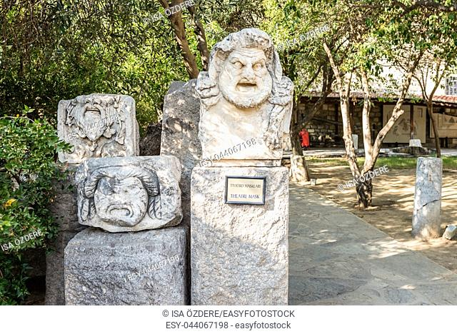 Theater masks Roman marble sculpture or blocks in Castle of St. Peter or Bodrum Castle, Turkey