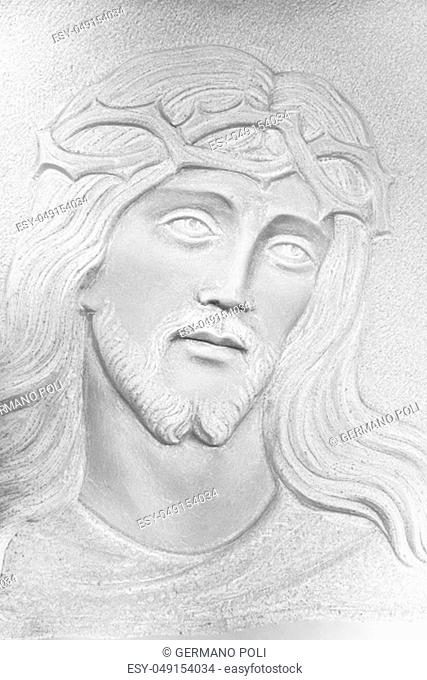 Stone white Bas-relief of the face of Christ with a crown of thorns. Ideal for concepts and backgrounds