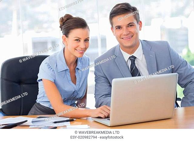 Smiling business people working together in the office