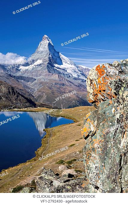 The tip of the Matterhorn is reflected in Stellisee. Zermatt Canton of Valais Pennine Alps Switzerland Europe