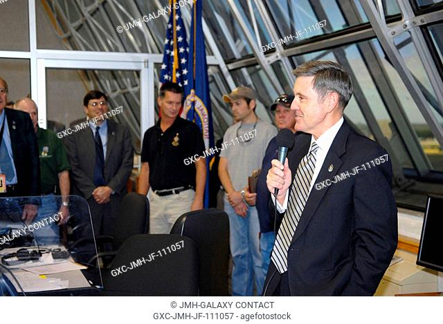 In Firing Room 4 of NASA Kennedy Space Center's Launch Control Center, Kennedy Director Bob Cabana congratulates the launch team upon the successful launch of...
