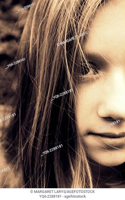 Portrait of a beautiful sad teenage girl in sepia