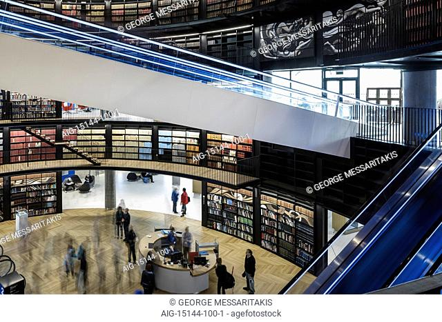 Birmingham Library. Interior view of public library. Curved walls lined with bookshelves and illuminated escalators. Contemporary architecture and design
