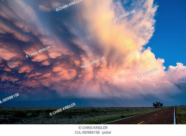Beautiful display of mammatus clouds over New Mexico desert landscape, USA
