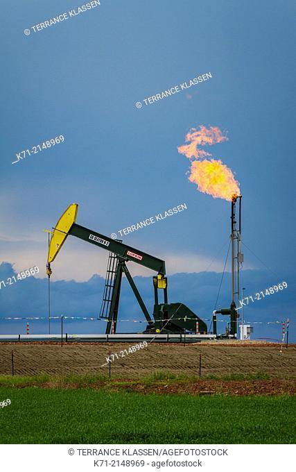 Natural gas flaring and a pumper in the Bakken shale oil fields near Williston, North Dakota, USA