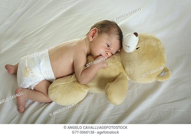newborn baby with teddy bear
