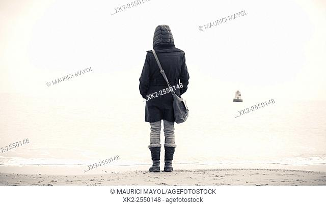 woman standing in front of the North sea