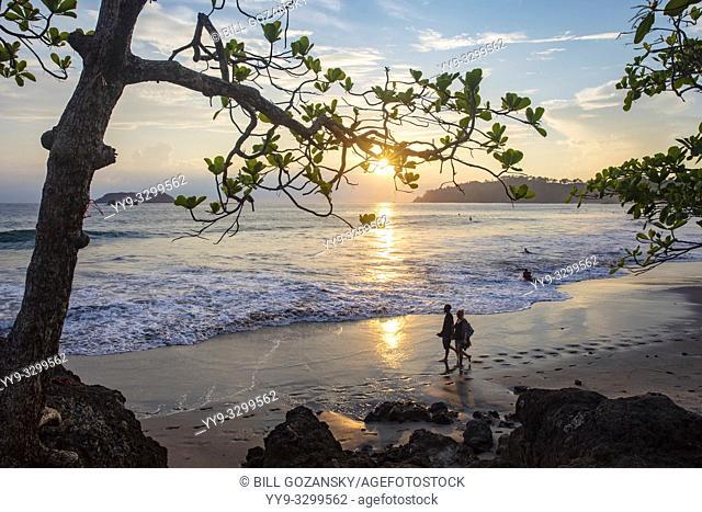 Couple walking in the sunset on Espadilla Norte Beach, Manuel Antonio, Quepos, Costa Rica