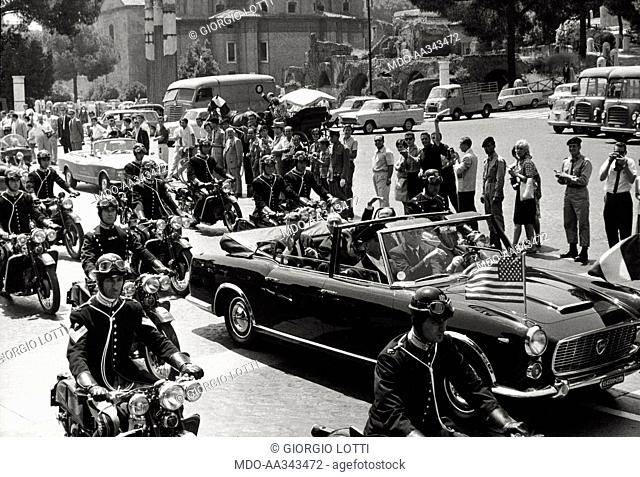 John Fitzgerald Kennedy in Italy. The President of the United States John Fitzgerald Kennedy is visiting Italy. He is on a car with the President of the Italian...