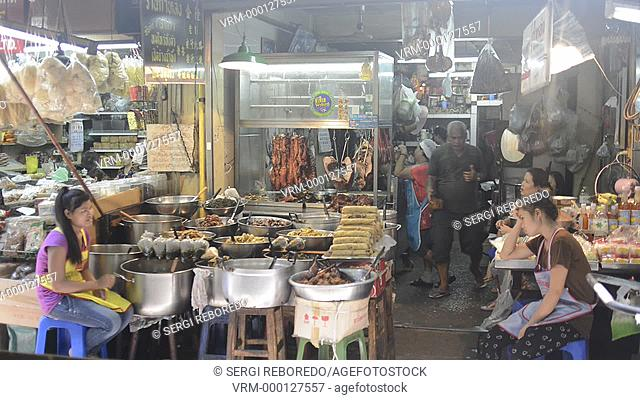 Market stall and street food being prepared in Chinatown Bangkok, Thailand. Yaowarat, Bangkok's Chinatown, is the World's most renowned street food destination...