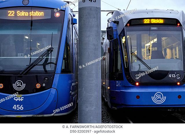 Two trams side by side at the Solna Station. Stockholm, Sweden