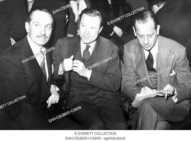 Frederick March, Walter Reuther, and Melvyn Douglas at UAW rally for workers striking GM. Feb. 15, 1946. The United Auto Workers fundraiser was at Detroit's...