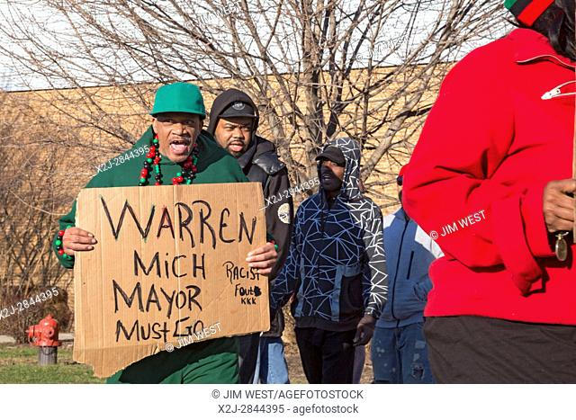 Warren, Michigan USA - 28 March 2017 - Activists picketed a meeting of the Warren city council, calling for the resignation of Mayor James Fouts because of...