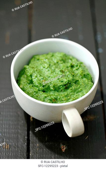 Homemade broccoli and spinach pesto in a cup