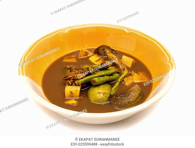 Curry spicy vegelable and fish grill on white background, Rainny season food