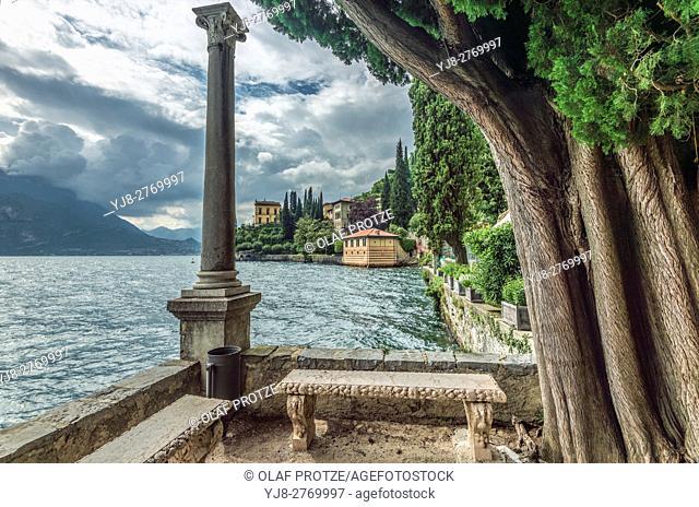 Stone garden bench at Botanic Garden of Villa Monastero, Varenna, Lombardy, Italy