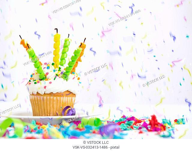 Birthday cupcake and confetti