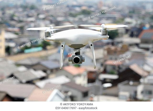 White drone flying over the city, cityscape of Kagawa, Japan