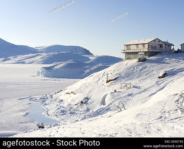 The traditional and remote greenlandic inuit village Kullorsuaq located at the Melville Bay, part of the Baffin Bay, in the far north of West Greenland