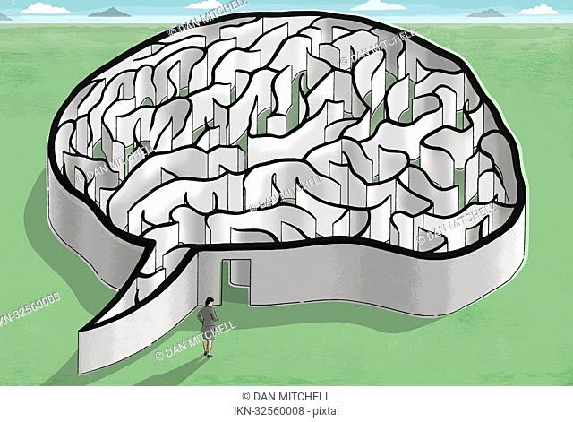 Businesswoman standing at entrance to brain maze