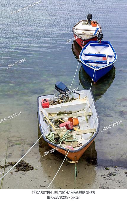 Three boats in a cornish harbor, Cornwall, England, Great Britain, Europe