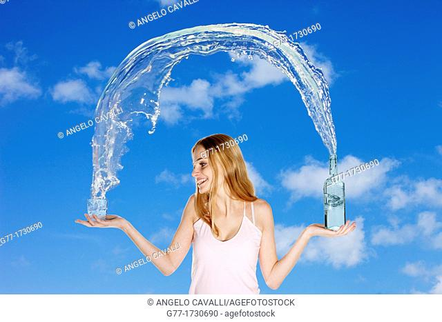 Woman pouring water from a bottle in a glass