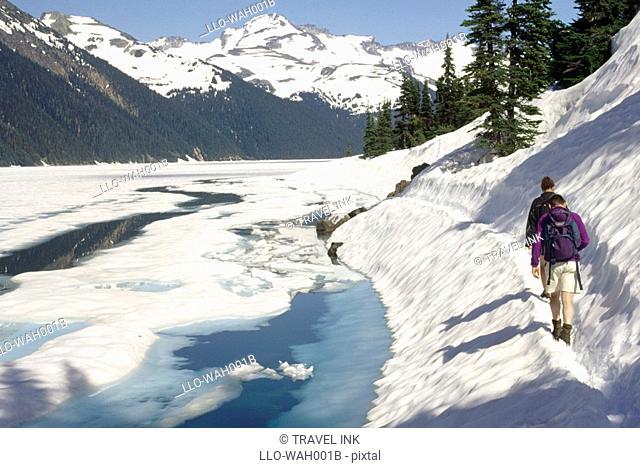 Hikers Walking Along a Snow Covered Path  Garibaldi Lake, British Columbia, Canada