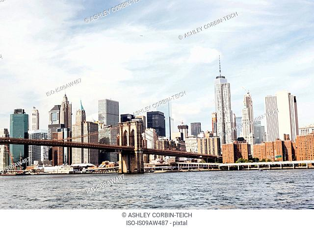 Cityscape view of Brooklyn Bridge over East river, New York, USA