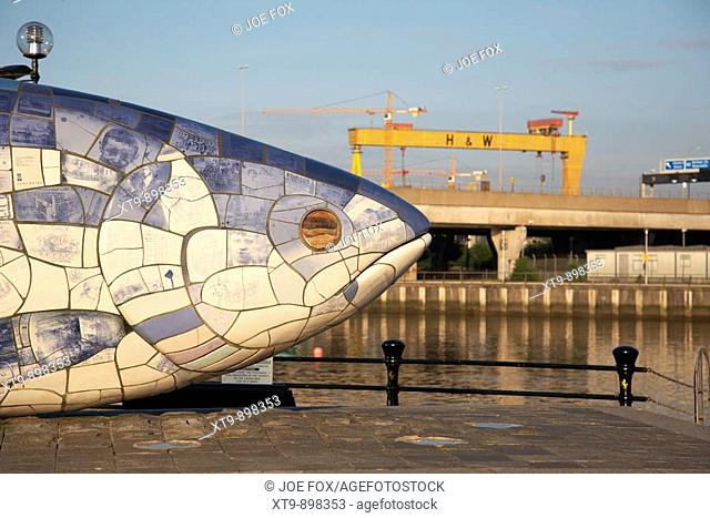 'The Big Fish' Salmon sculpture by John Kindness next to the River Lagan in Belfast City Centre, Northern Ireland, UK