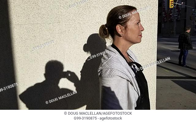 A woman poses in profile in the late afternoon, Windsor, Canada