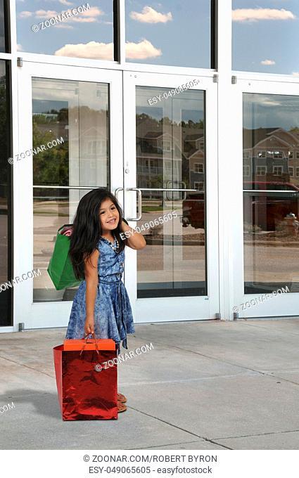 Beautiful litte girl on a shopping spree