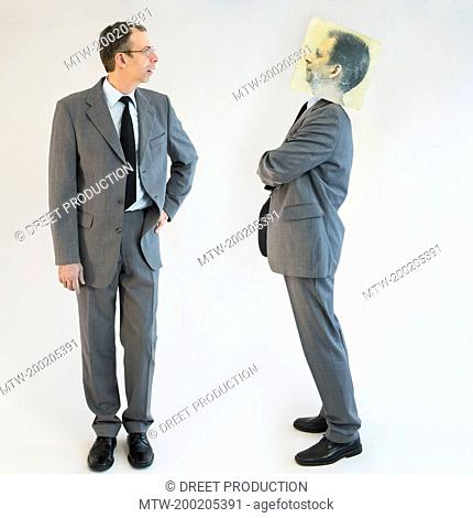 Businessman imagining self image of defiance