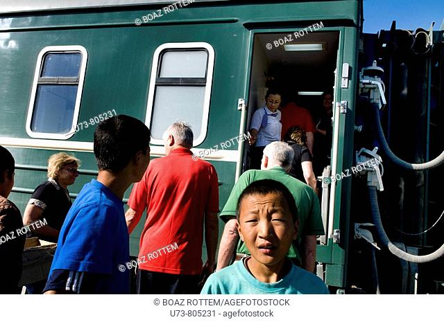 Mongolian tran stops at a small station in Mongolia