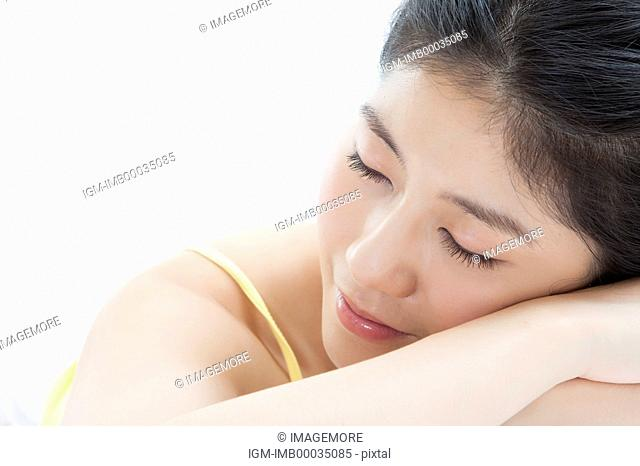 Young woman lying on front and sleeping