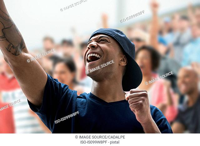 Man cheering at sports game