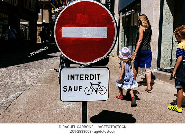 Woman with children walking on street passing next to ''no entry'' signal, Vannes, Morbihan, Brittany, France