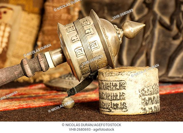 Tibetan hand prayer wheel with rolled-up paper bearing inscribed mantras. Katmandu. Nepal. Asia