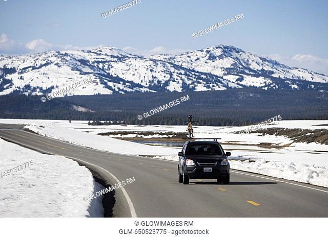 Car on the road, Grand Teton National Park, Wyoming, USA