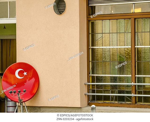 satellite receiver dish in the colors of the turkish national flag in front of a restaurant, stuttgart, baden-wuerttemberg, germany