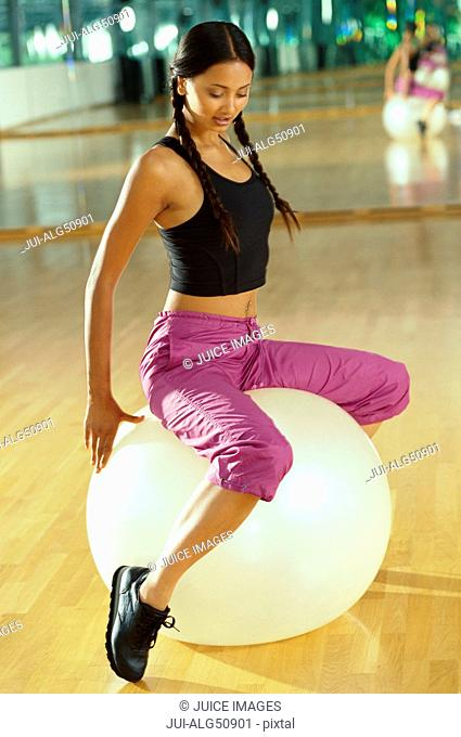Woman using exercise ball at gym