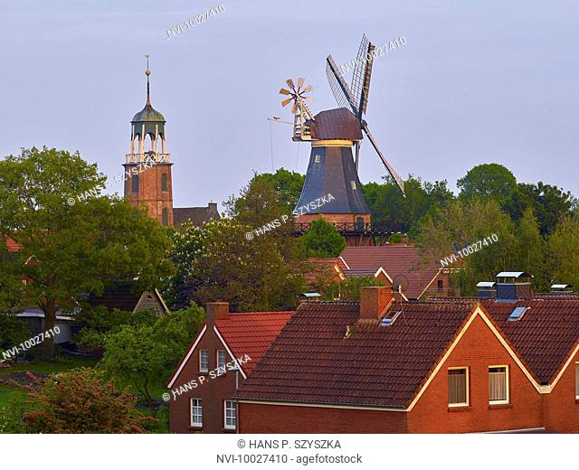 Church tower and mill of Ditzum, Jemgum, East Frisia, Lower Saxony, Germany